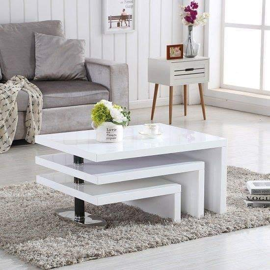 Rotating white coffee table design