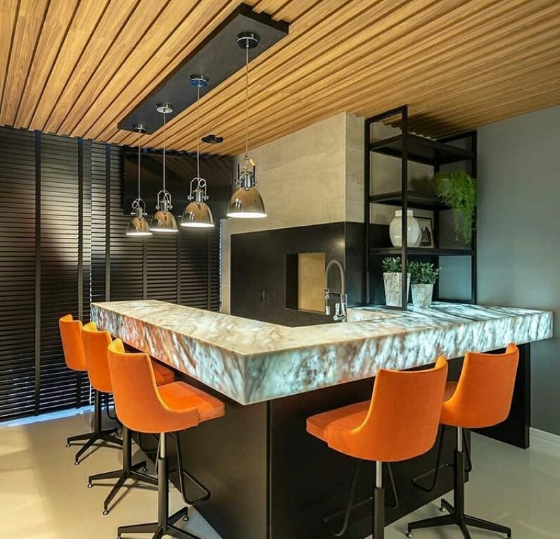 minibar with five orange color chairs