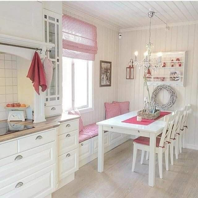 small kitchen with two windowss