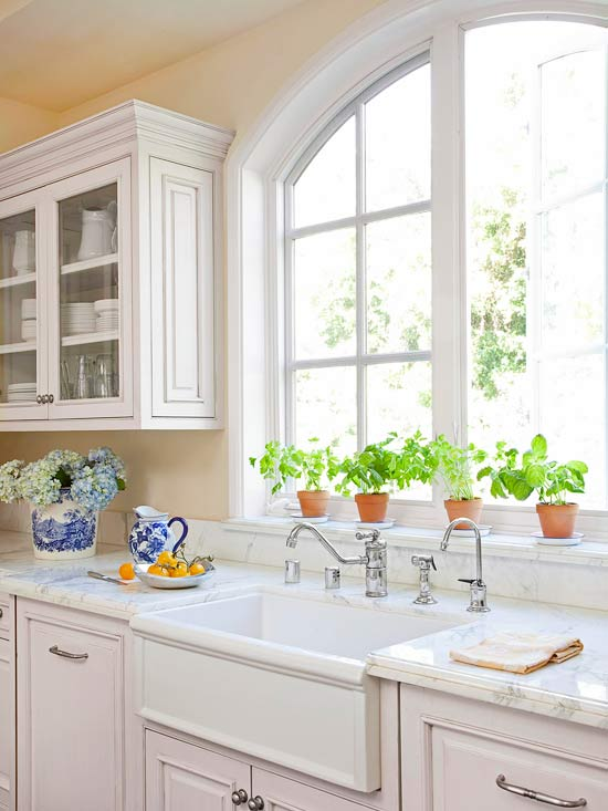 kitchen with small multiple plant pots near water pump