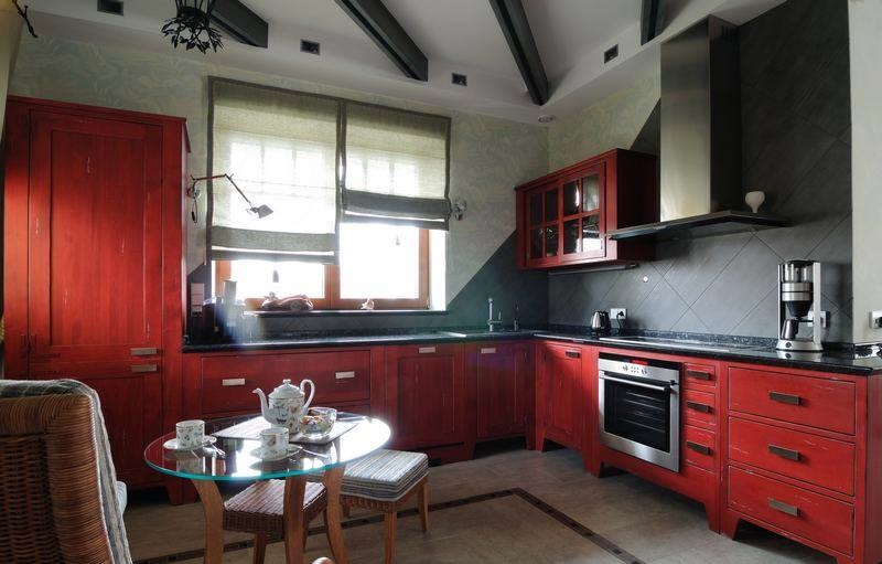 normal kitchen with red color cupboards and cabinet