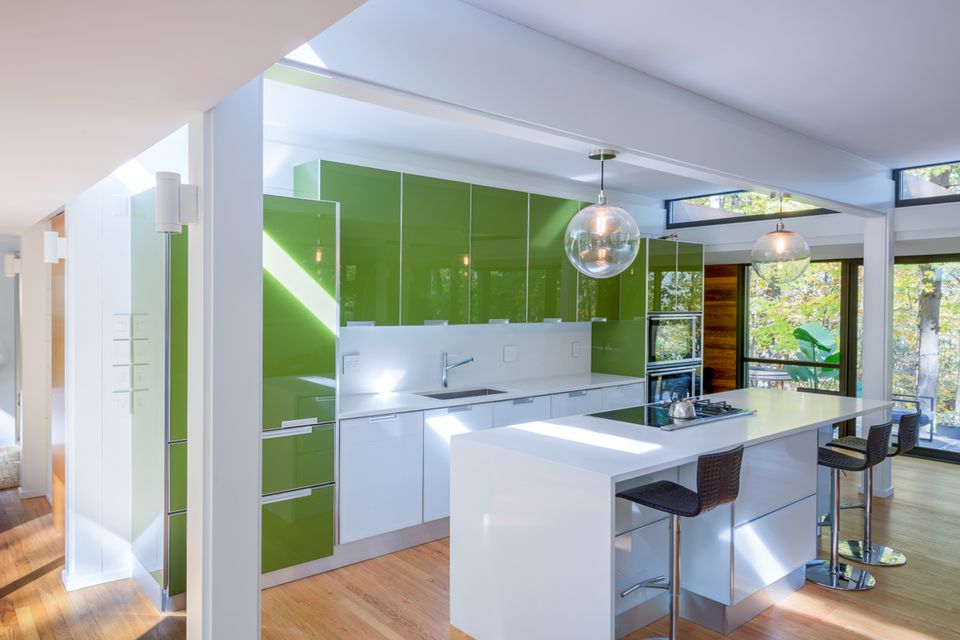 modern green kitchen design with trees nearby