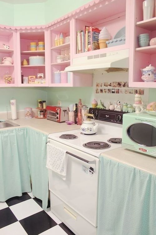 kitchen with rose color cabinet at top of wall