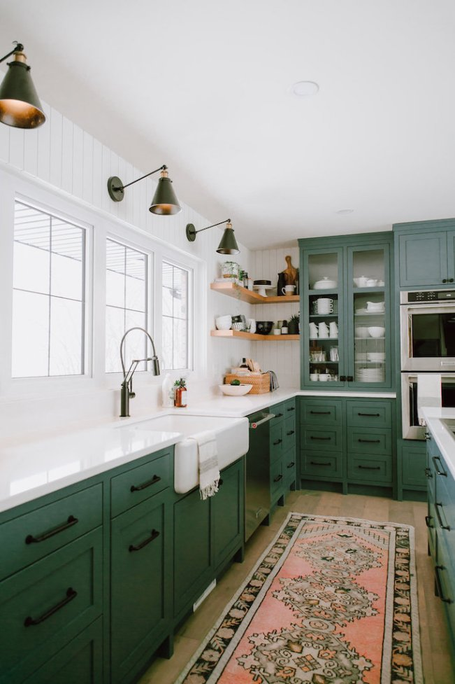 kitchen with many green color cabinets