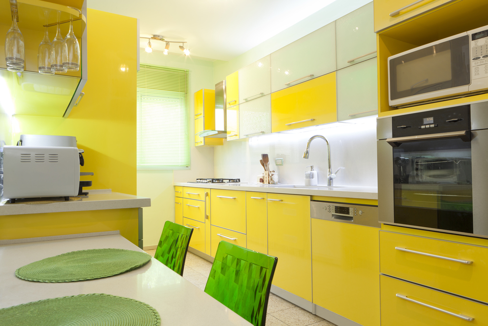 Yellow kitchen decor with modern stylish items